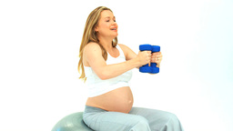 Pregnant lady with dumbbells Stock Video Footage
