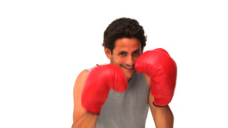 Handsome man with red boxing gloves Footage