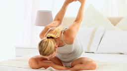 Cute blonde woman stretching herself Footage