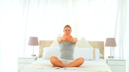 Blonde woman doing the lotus position Stock Video Footage
