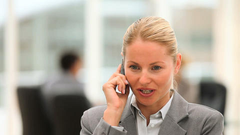 Attractive business woman speaking on the phone Stock Video Footage