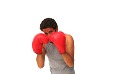 Darkhaired man with boxing gloves Stock Video Footage