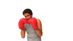Darkhaired man with boxing gloves Footage