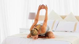 Cute blonde woman stretching herself Stock Video Footage