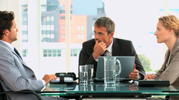 Threesome of business people Stock Video Footage