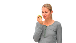 Happy woman eating an apple Footage
