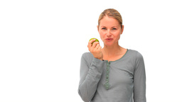 Happy woman eating an apple Stock Video Footage
