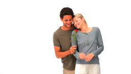 Man offering a rose to his pretty wife Stock Video Footage