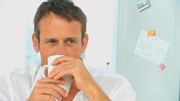 Relaxed man drinking a cup of coffee Stock Video Footage