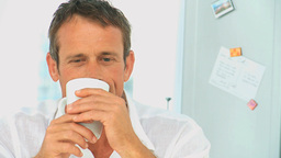 Relaxed man drinking a cup of coffee Footage