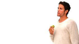 Darkhaired man eating an apple Footage
