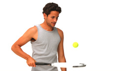 Darkhaired man with a racket and tennis ball Footage