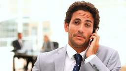 Handsome business man speaking on the phone Stock Video Footage