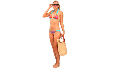 Blonde woman in swimsuit with a bag Stock Video Footage