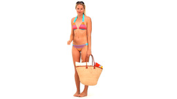 Blonde woman in swimsuit with a bag Footage