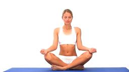 Blonde lady meditating Footage