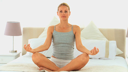Lovely woman meditating in lottus position Footage