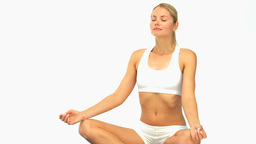 Cute woman meditating Footage