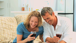 Lovely couple enjoying a red wine Footage