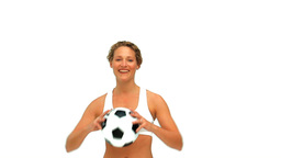 Cute woman holding a soccer ball Stock Video Footage