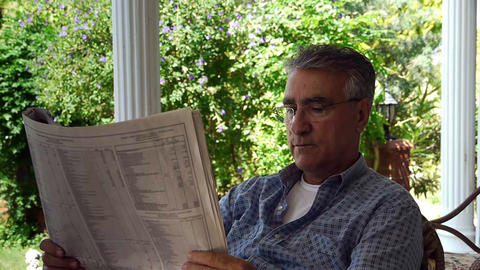 Old retired man reading newspaper - Leisure Stock Video Footage