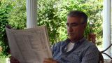 Old Retired Man Reading Newspaper  - Leisure stock footage