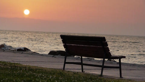 Bench by sea at sunset - Nature Footage