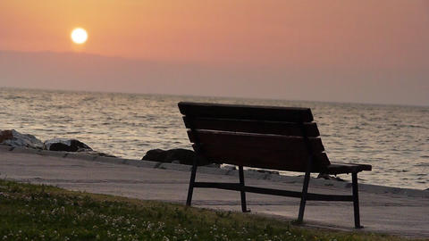 Bench by sea at sunset - Nature Stock Video Footage