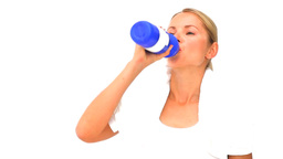 Blonde woman after sports drinking water Stock Video Footage