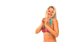 Blonde woman in swimsuit playing Stock Video Footage