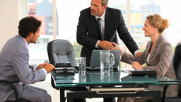 Threesome of business people during a meeting Stock Video Footage