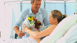 Man bringing flowers to his pregnant wife Footage