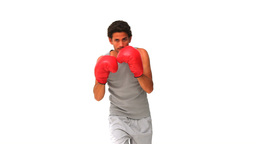 Dynamic handsome man with red boxing gloves Footage