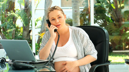 Expecting woman talking on the phone Stock Video Footage