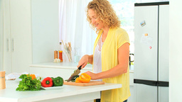 Curly haired woman preparing the dinner Stock Video Footage