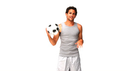 handsome man playing with a soccer ball Footage