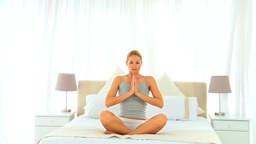 Blonde woman in lotus position Footage