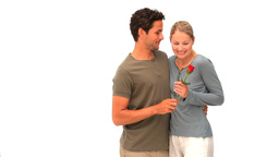 Man giving a red rose to his wife Footage