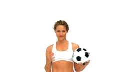 Woman playing with a soccer ball Footage