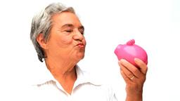 Senior woman saving money Footage