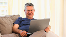 Retired man with his laptop Footage
