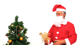 Santa Claus decorating the Christmas tree Stock Video Footage