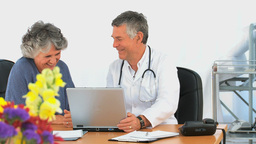 Doctor and his patient looking at the laptop Stock Video Footage