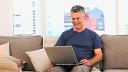 Mature man looking at his laptop Stock Video Footage