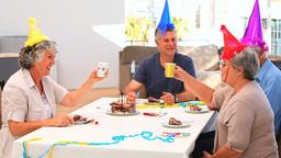 Elderly friends on birthday Footage