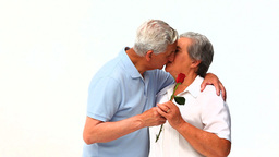 Mature man offering a rose to his wife Footage