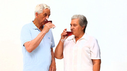 Senior couple drinking red wine Footage