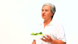Woman eating a salad Footage