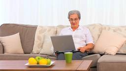 Senior woman working on her laptop Stock Video Footage