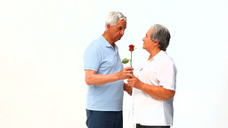 Man offering flowers to his wife Footage